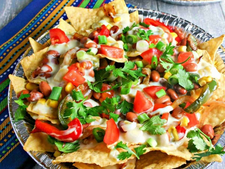 vegetarian nachos with pinto beans, peppers, and cheese sauce