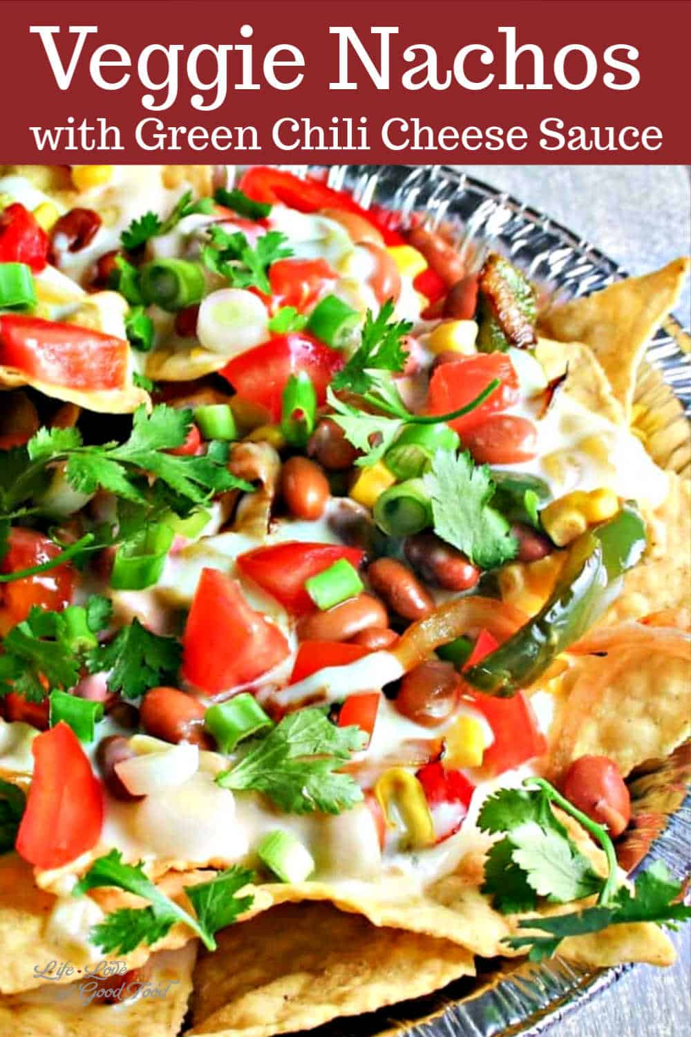 These loaded Vegetarian Nachos piled high with sautéed onions and peppers, pinto beans, and sweet corn are smothered with a creamy green chili cheese sauce.