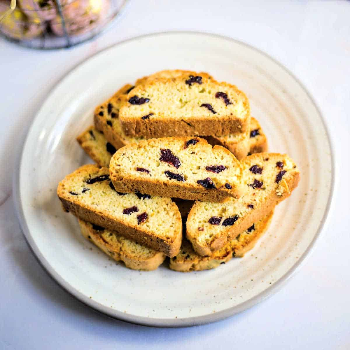 a stack of cherry biscotti on a white plate