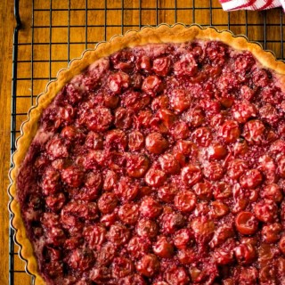 sour cherry tart on a wire rack