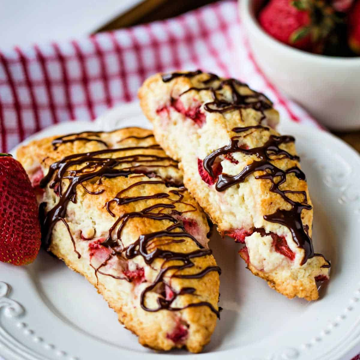 fresh strawberry scones on a white plate
