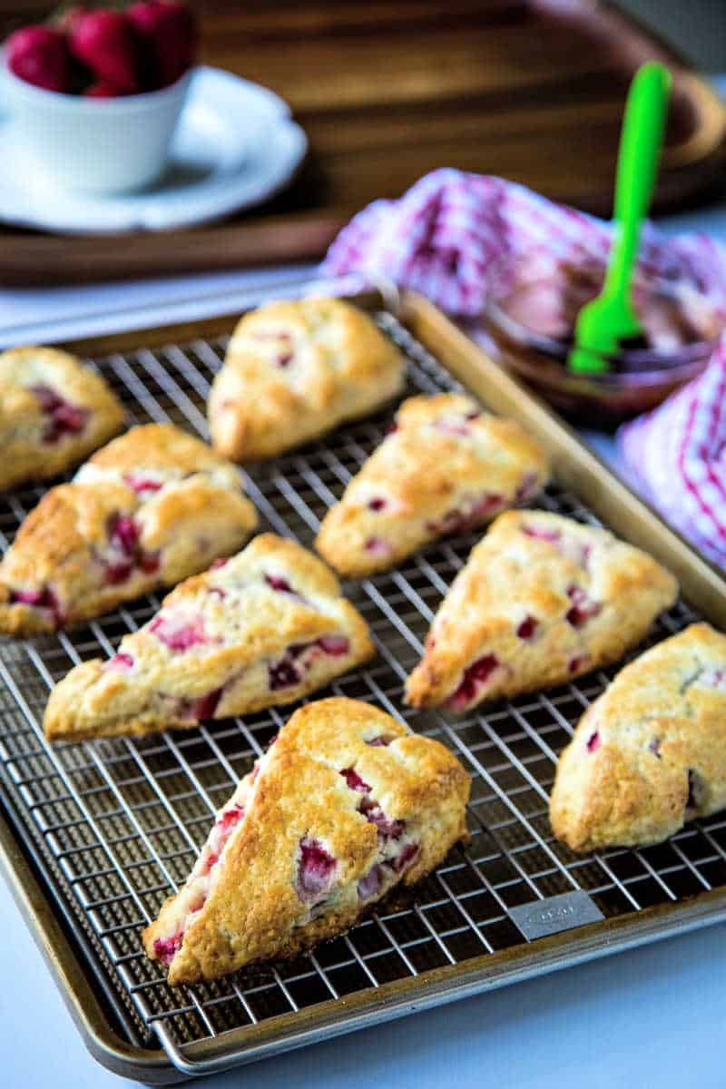 fresh strawberry scones on a wire rack