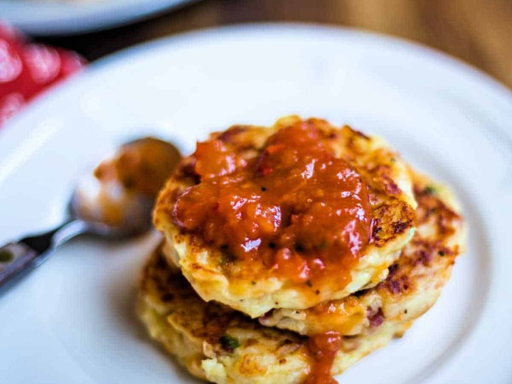 Tex-Mex mashed potato cakes with salsa on a white plate