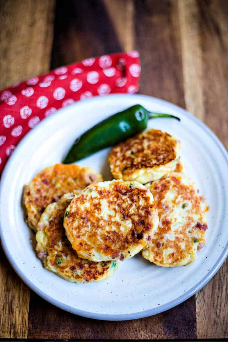 Tex-Mex Mashed Potato Cakes on a white plate with jalapeno pepper