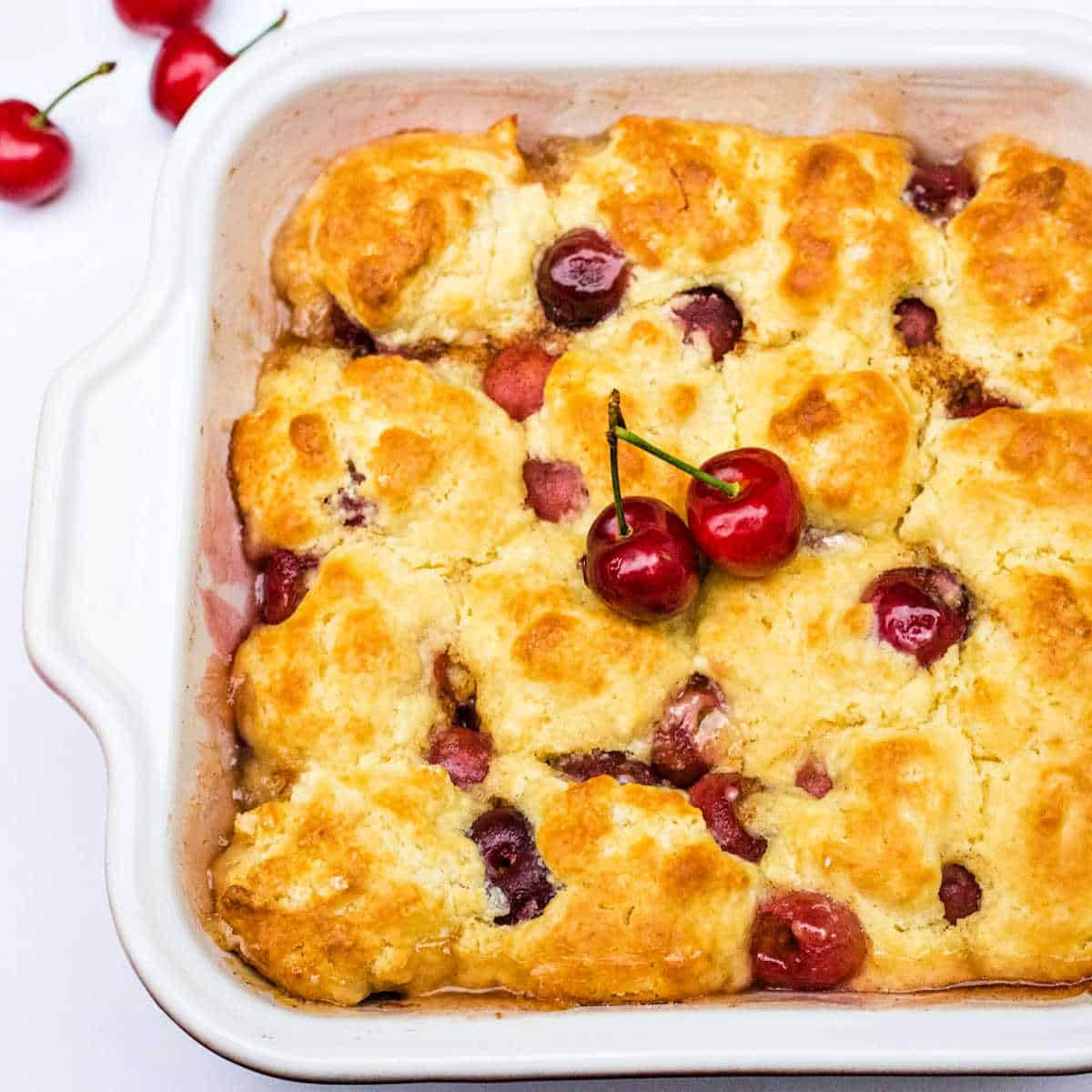 peach cherry cobbler in a baking dish fresh from the oven