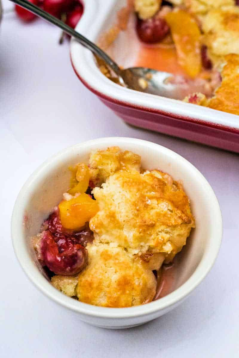 a serving of peach cherry cobbler
