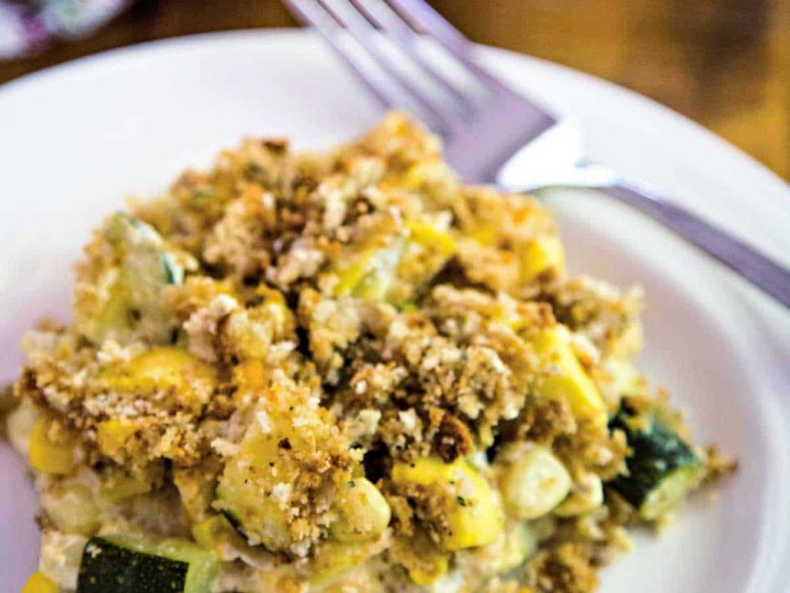 a serving of squash and zucchini casserole on a white plate