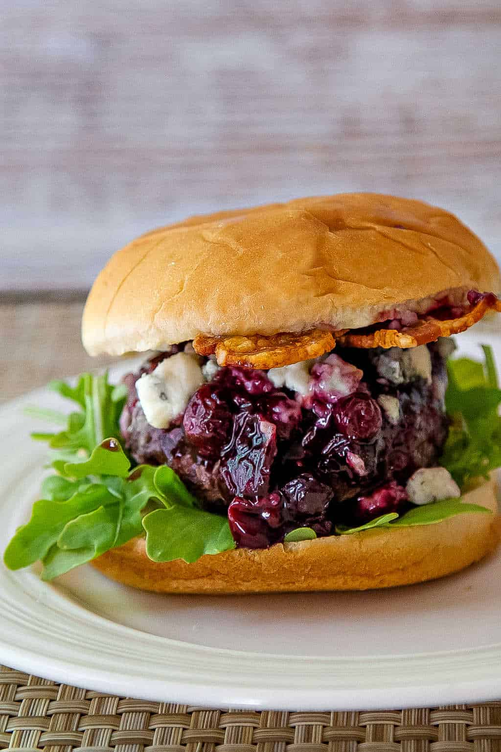 Blueberry Blue Cheese Bacon Burger on a white plate