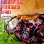 a burger with blueberry barbecue sauce dripping off the sides