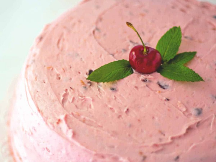 fresh cherry cake with fresh mint and buttercream frosting