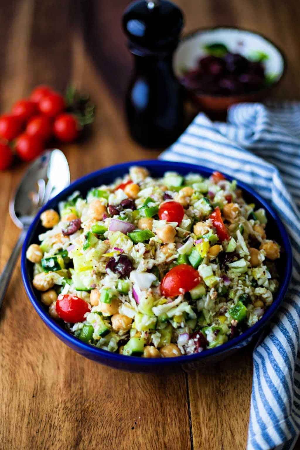healthy greek coleslaw in a blue bowl