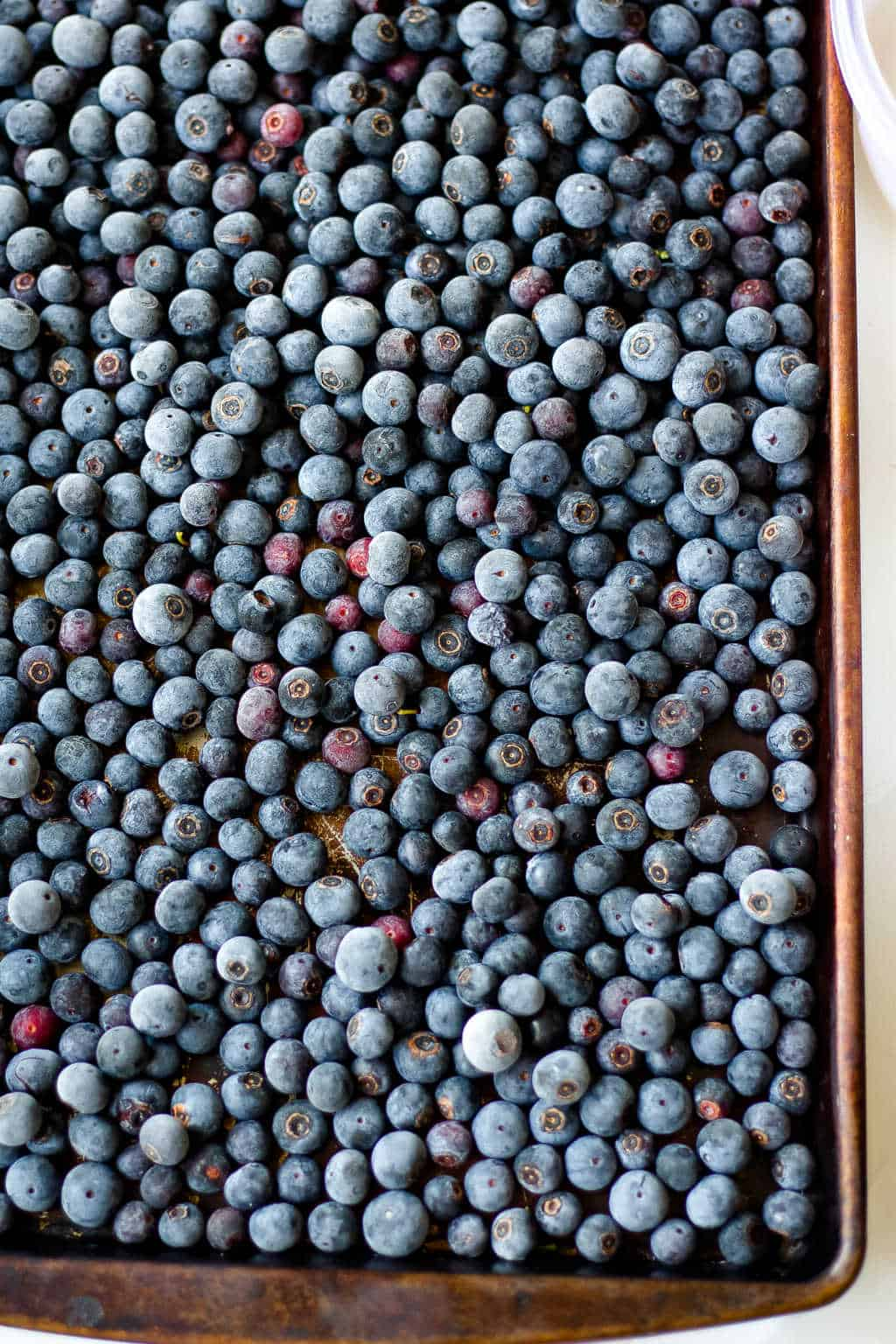 frozen blueberries on a baking sheet