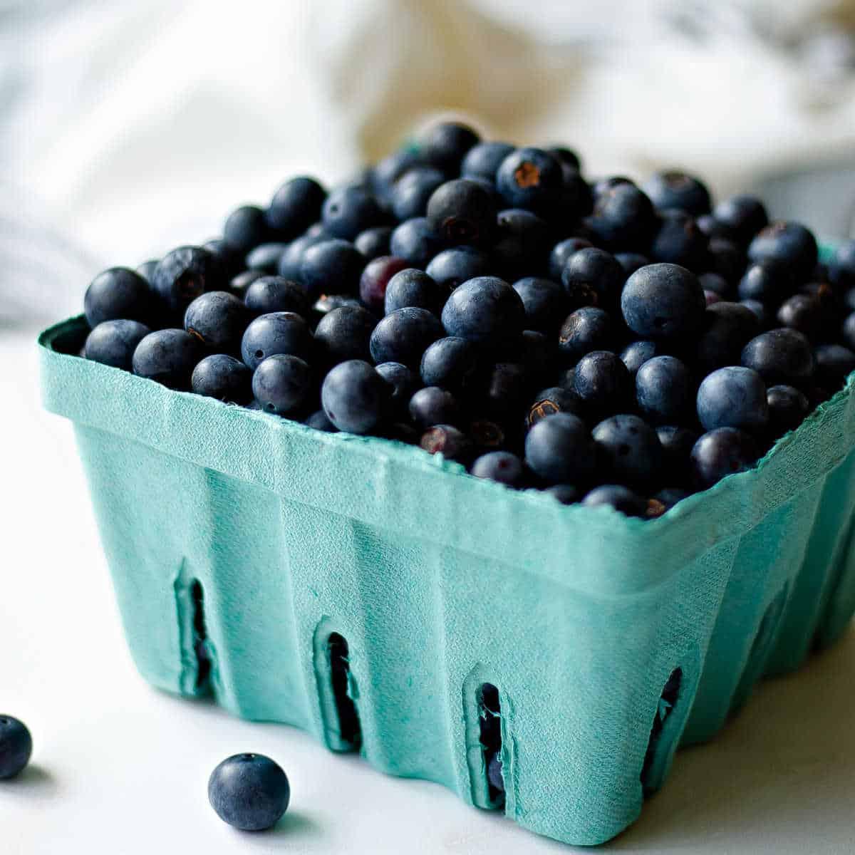 fresh blueberries in a cardboard crate