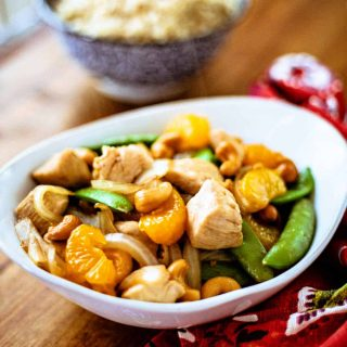 Easy Orange Cashew Chicken with a bowl of rice