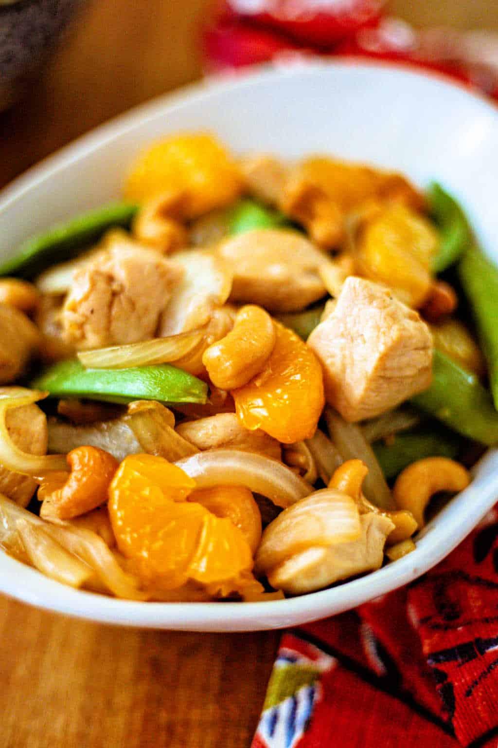 Easy Orange Cashew Chicken in a white bowl