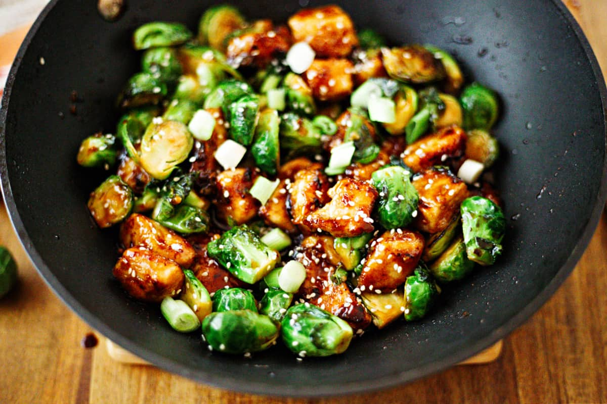 Sriracha Chicken and Brussels Sprouts Stir Fry in a wok