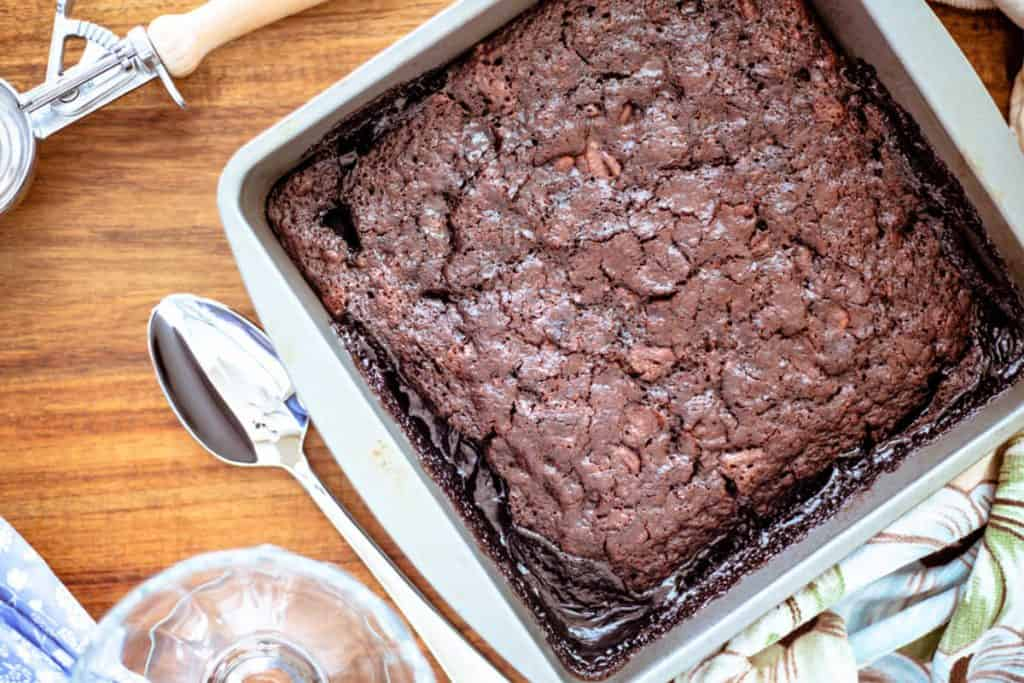 A chocolate pudding cake sitting on top of a wooden table