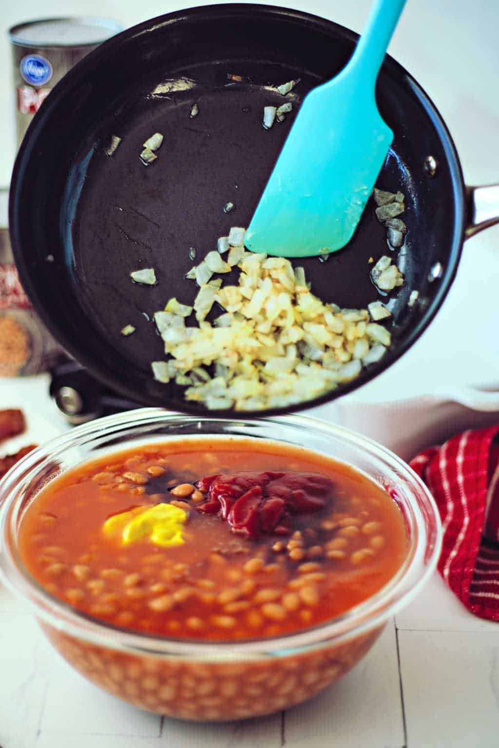 preparing baked beans with onions