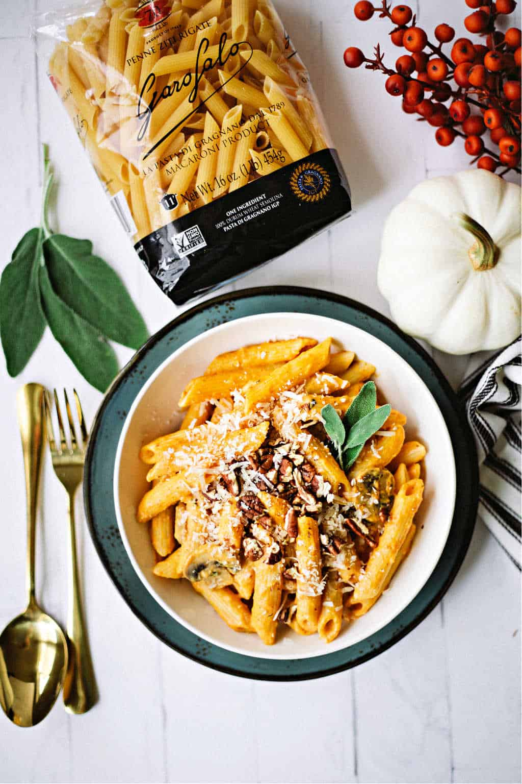 a bowl of penne pasta with pumpkin sauce and a package of Garafalo pasta