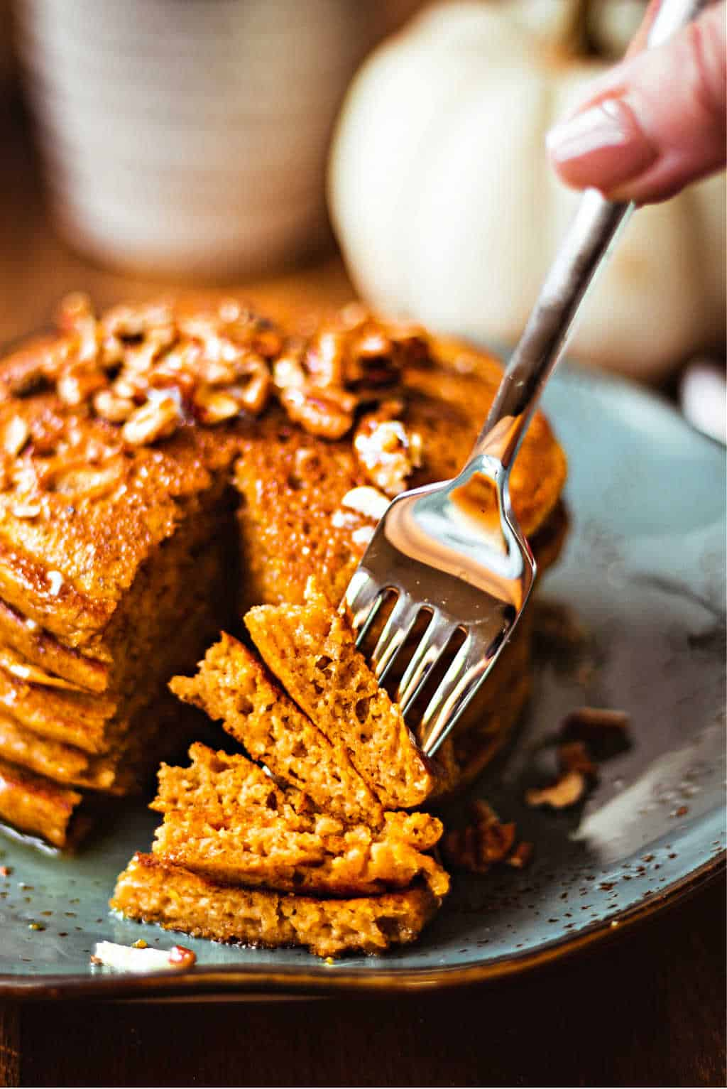 Pumpkin Spice Pancakes speared with a fork