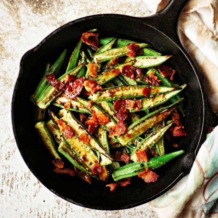 roasted okra in a cast iron skillet