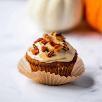 maple glazed bacon muffin in a paper liner