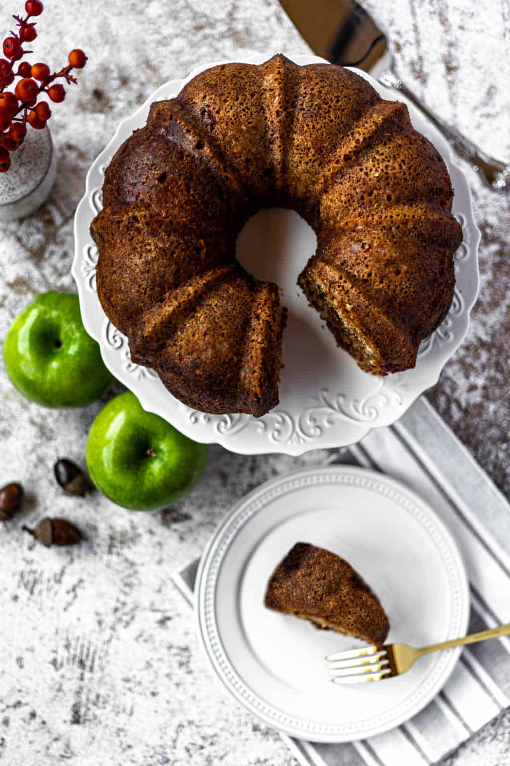 apple walnut bundt cake on a cake stand