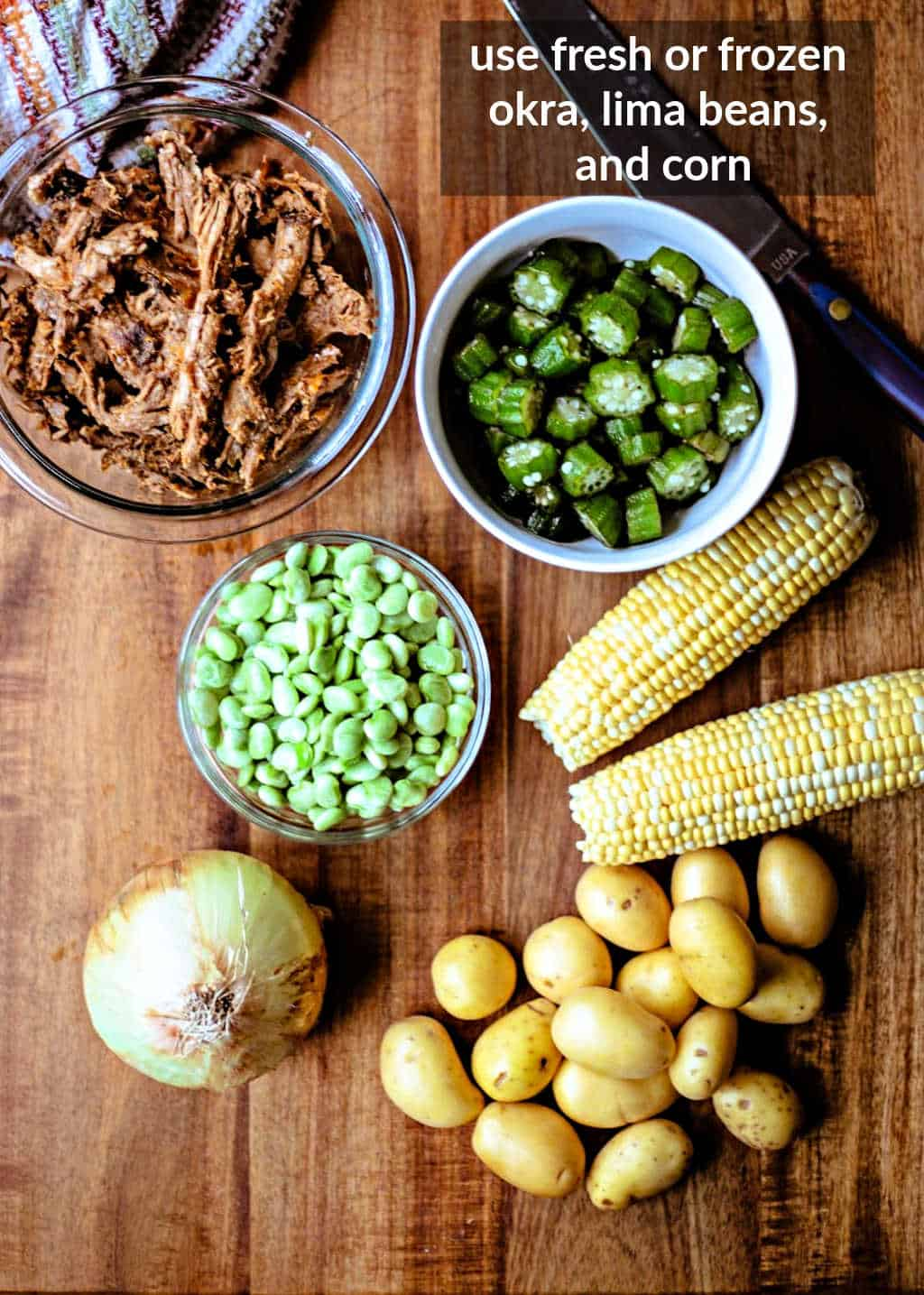 ingredients for Brunswick Stew on a wooden table
