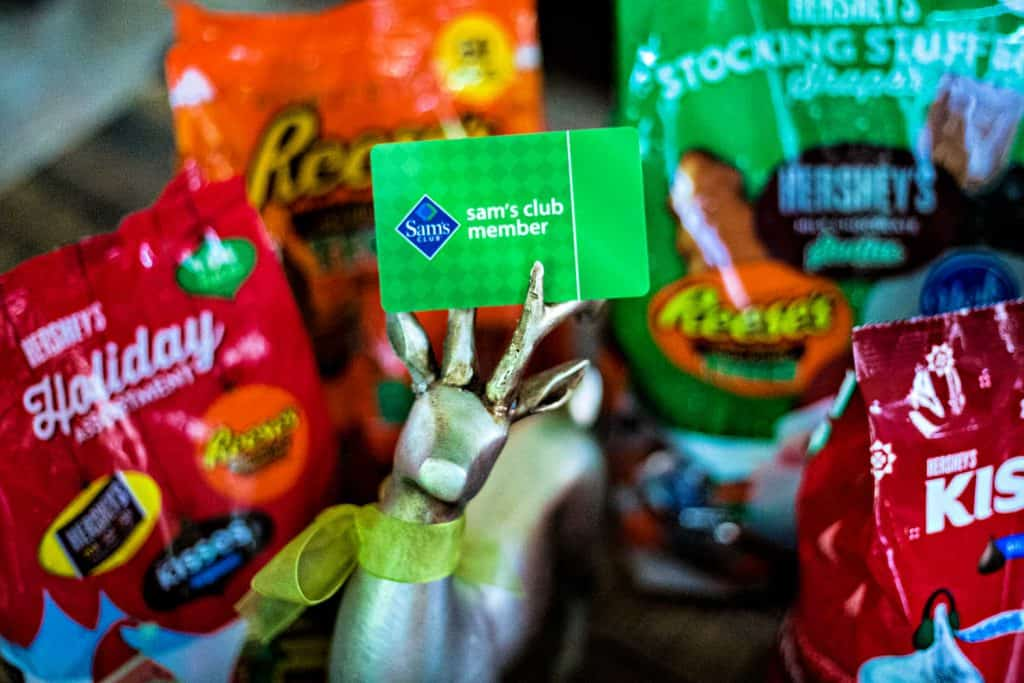 a sam's club card on a table with Hershey holiday candy
