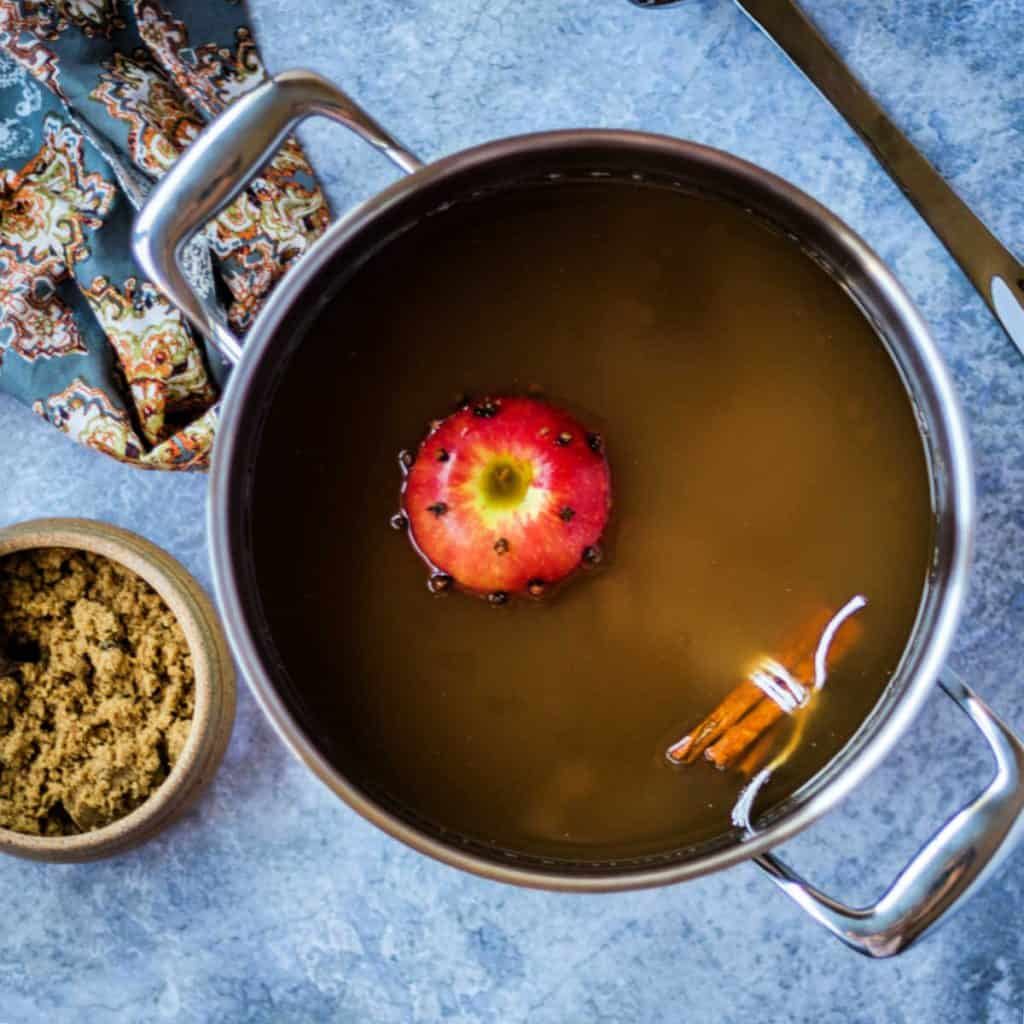hot apple cider with a floating apple