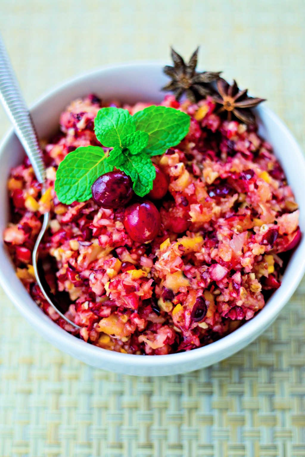 cranberry relish in a white bowl garnished with fresh mint