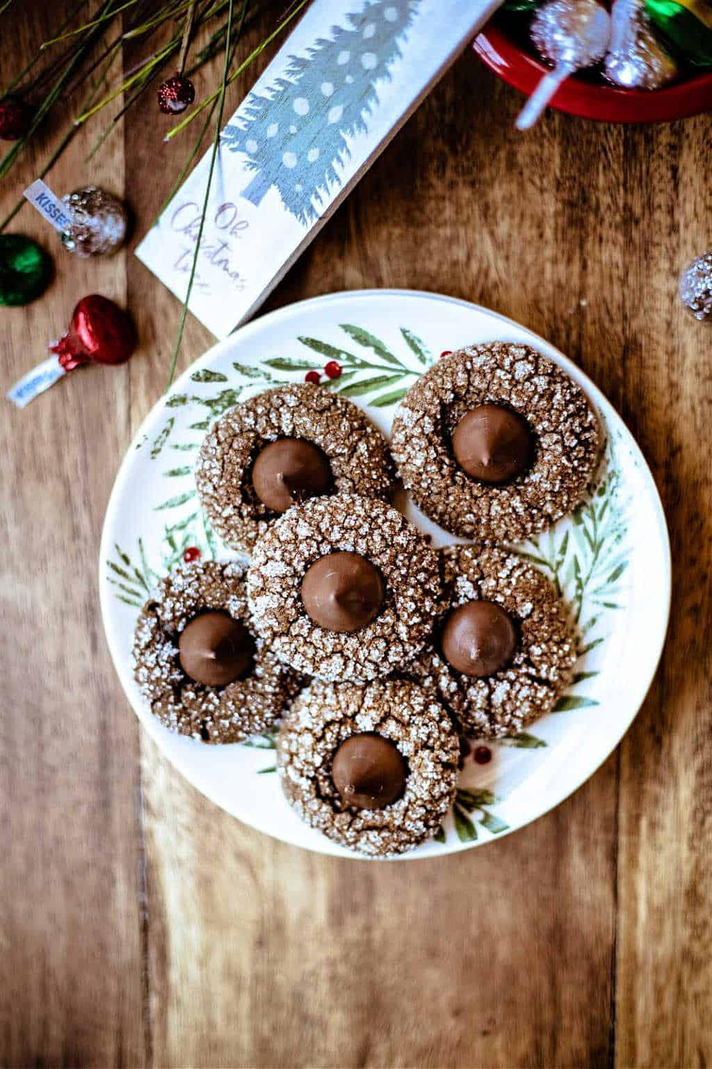 A plate of Gingerbread Kiss Cookies on a wooden table
