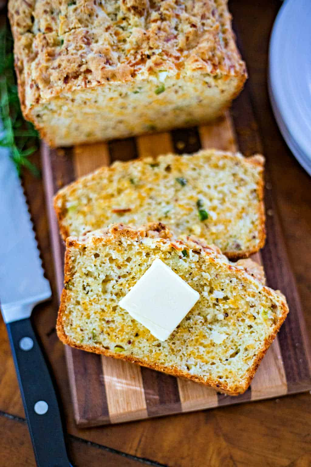 cheese bread loaf slices on a wooden board
