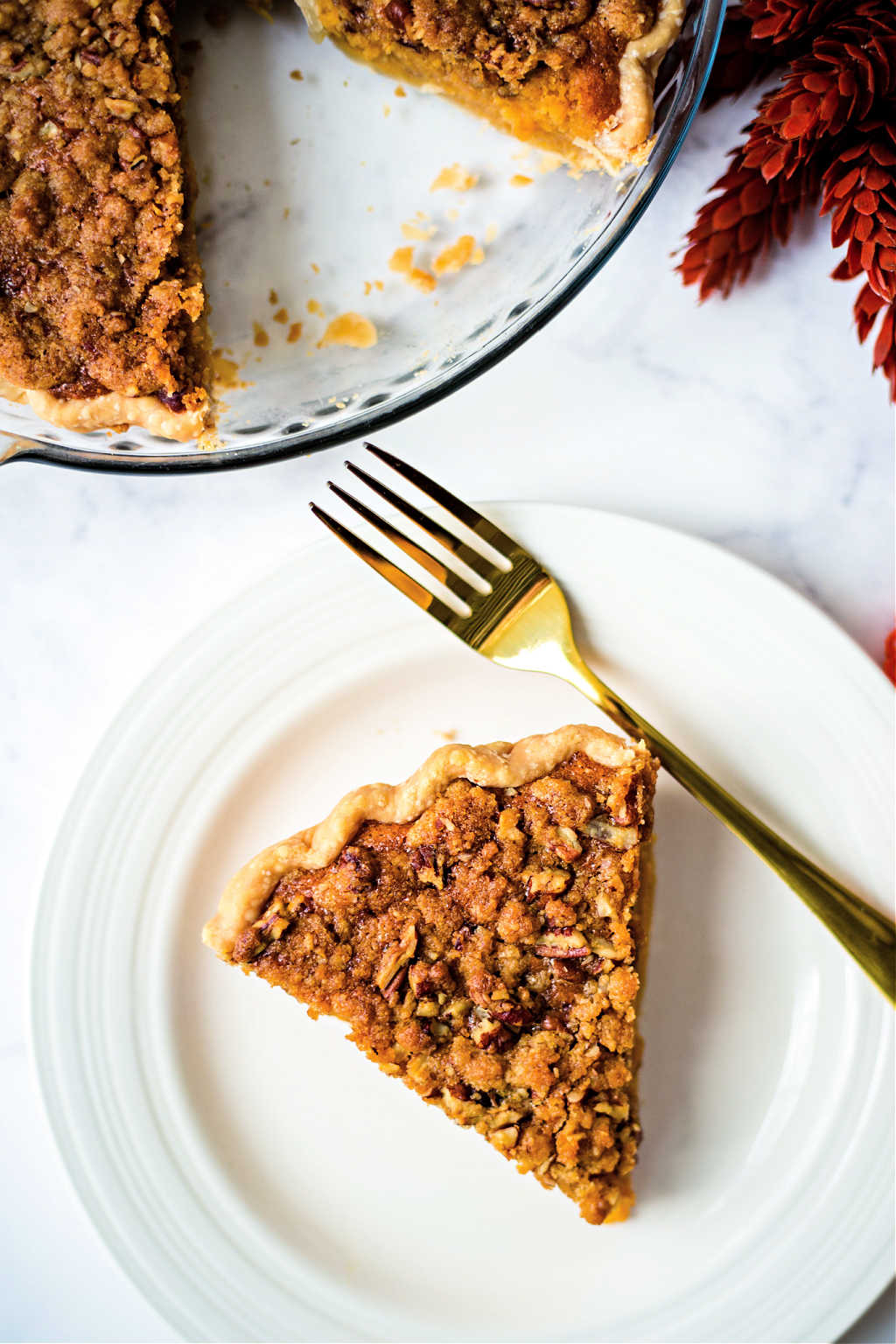 a slice of sweet potato pie on a white plate on a table