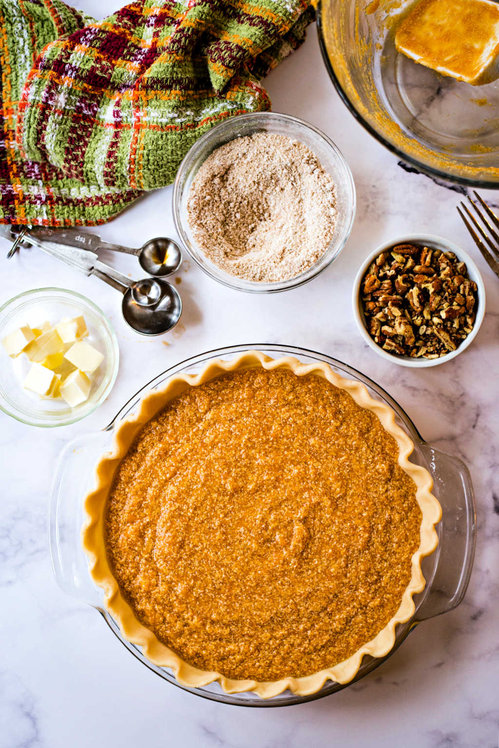 unbaked sweet potato pie on a table ready for the oven