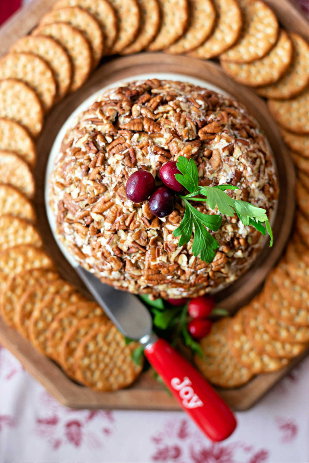 pineapple cheese ball on a tray with crackers