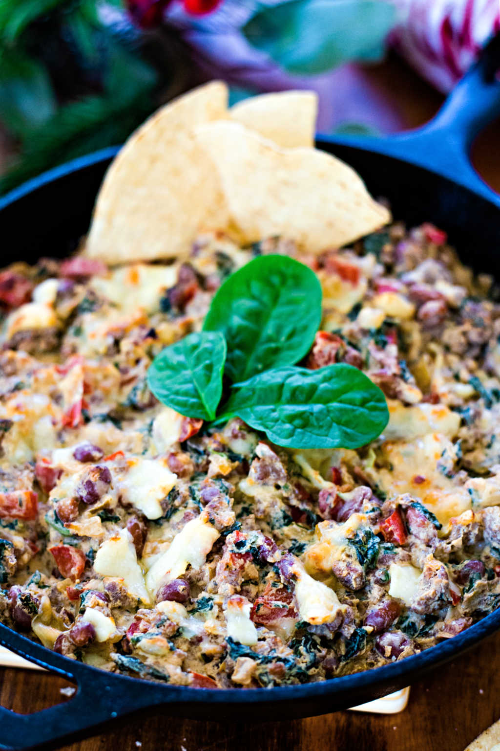 Sausage, Bean, and Spinach Dip in a cast iron skillet