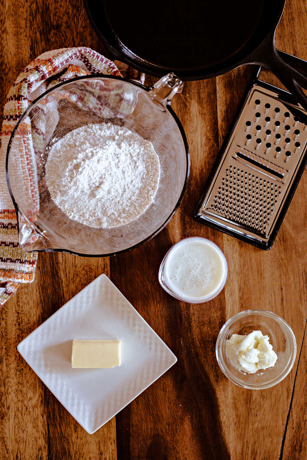 ingredients for biscuit bread in an iron skillet
