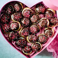 chocolate marshmallow cookies in a pink heart shaped box