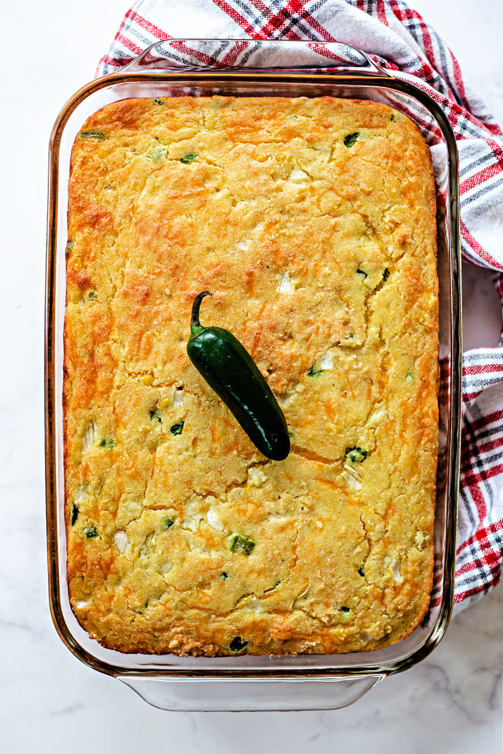 a pan of baked Mexican cornbread on a table