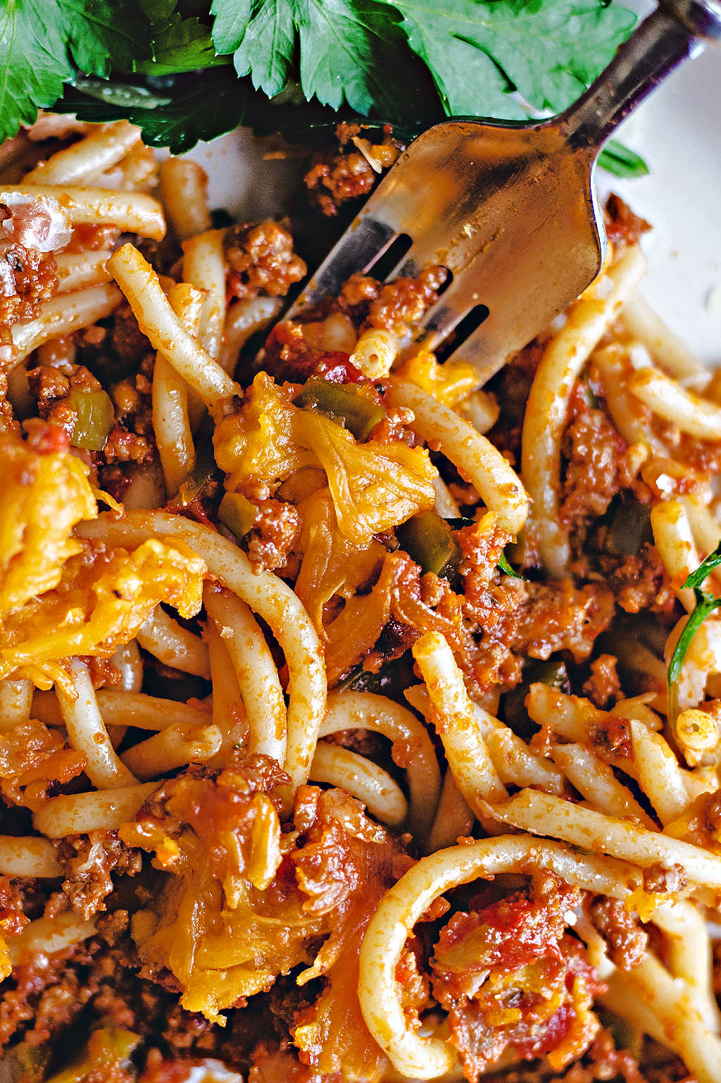 close up of baked spaghetti on a fork.