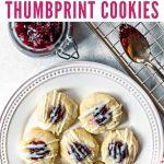 Lemon Raspberry Thumbprint Cookies on a white plate on a table with raspberry jam
