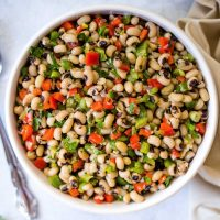 black eyed pea salad in a white bowl on a table.