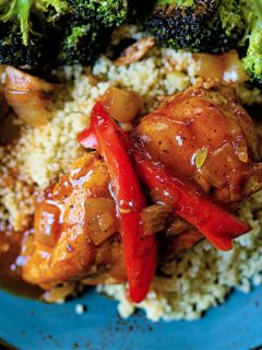 catalina chicken with couscous and broccoli on a blue plate
