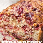 Strawberry Bread loaf on a white plate.