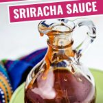 honey sriracha sauce in a glass decanter.