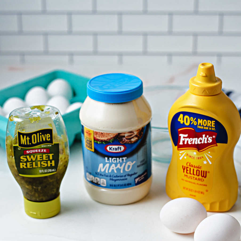 ingredients for making the filling for southern deviled eggs on a kitchen counter.
