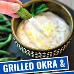 Grilled Okra on a black platter with a bowl of dipping sauce.