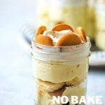 no bake banana pudding in small mason jars on a table.