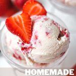 Homemade Strawberry Ice Cream in an ice cream bowl with fresh strawberry slices as a garnish.